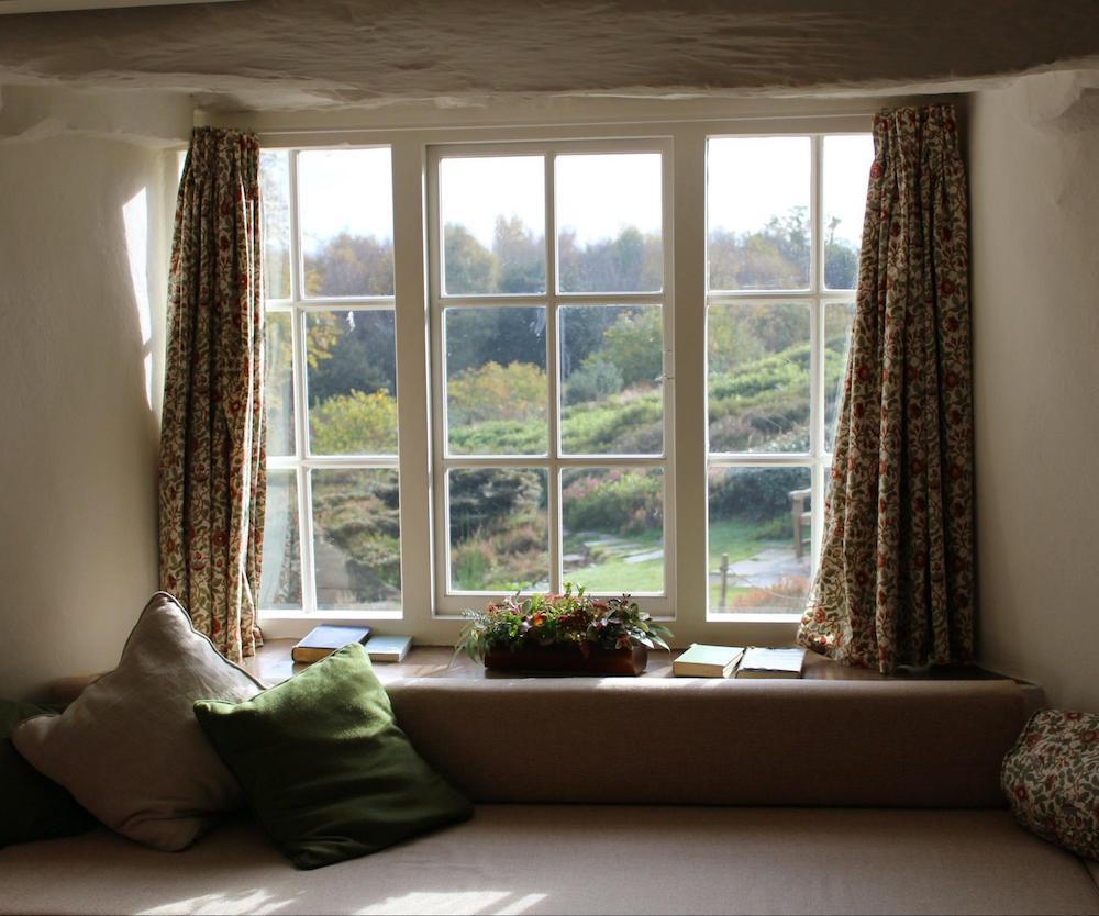 A sitting window that overlooks a field